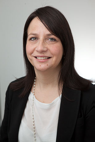 A portrait photograph of Carmel Walsh, one of the Solicitors acting in the breast implant scandal, at Pryers
