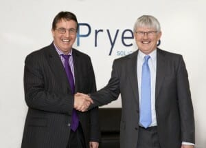 A photograph of Ian Pryer shaking hands with new Partner, Tim Gorman.