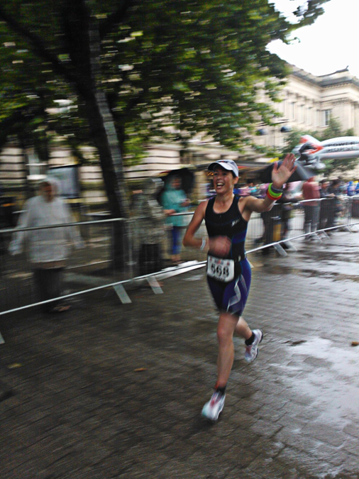 A photograph of Robyn Hawxby running in an ironman event.