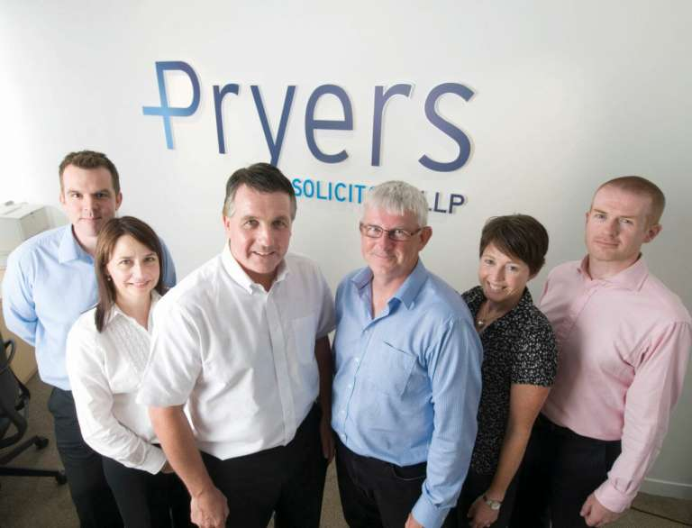 A photograph of the new partners at Pryers Solicitors, with Ian Pryer and Time Gorman
