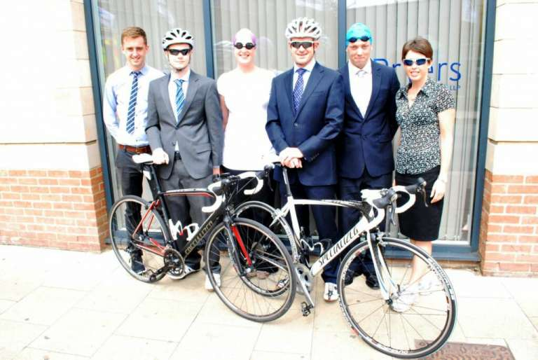 A photograph of the staff from Pryers Solicitors that will be taking part in the Sundowner Triathlon