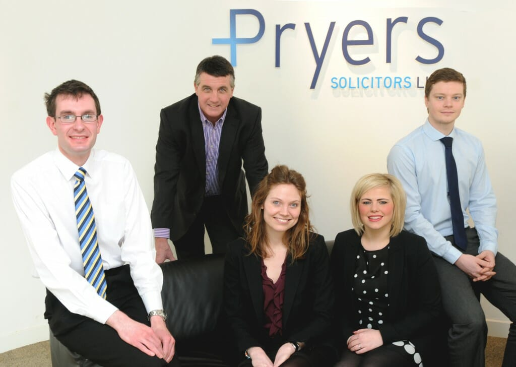 Pryers' trainees pictured with Ian Pryer and two of their newly qualified solicitors