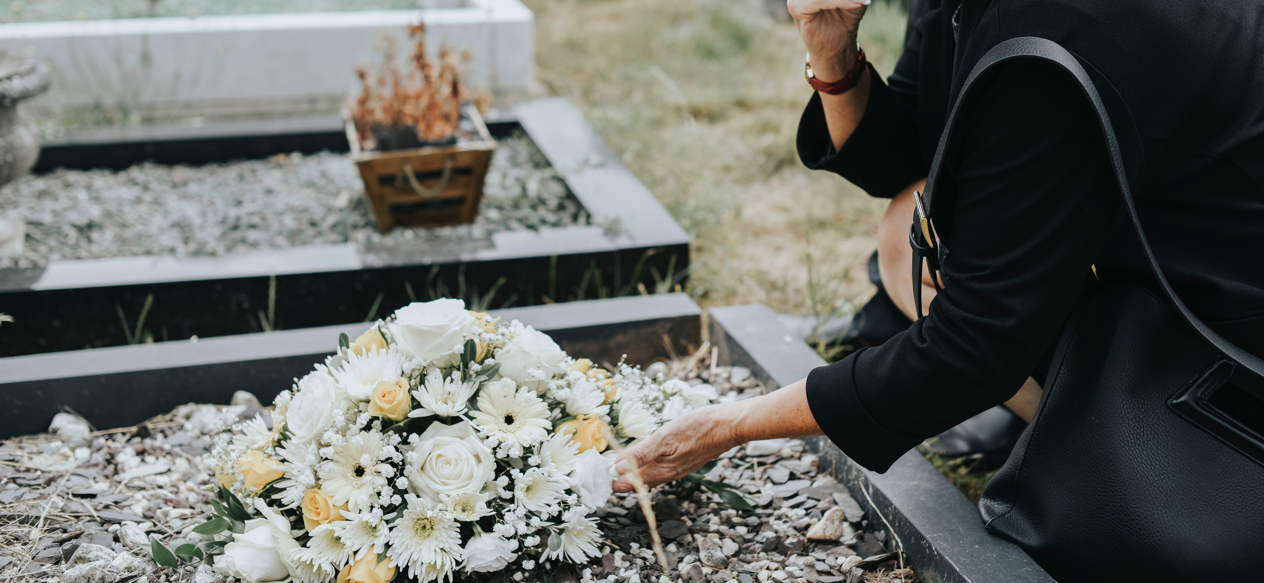 Woman standing over grave