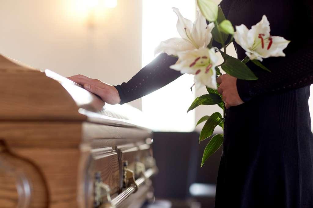 Woman touching casket