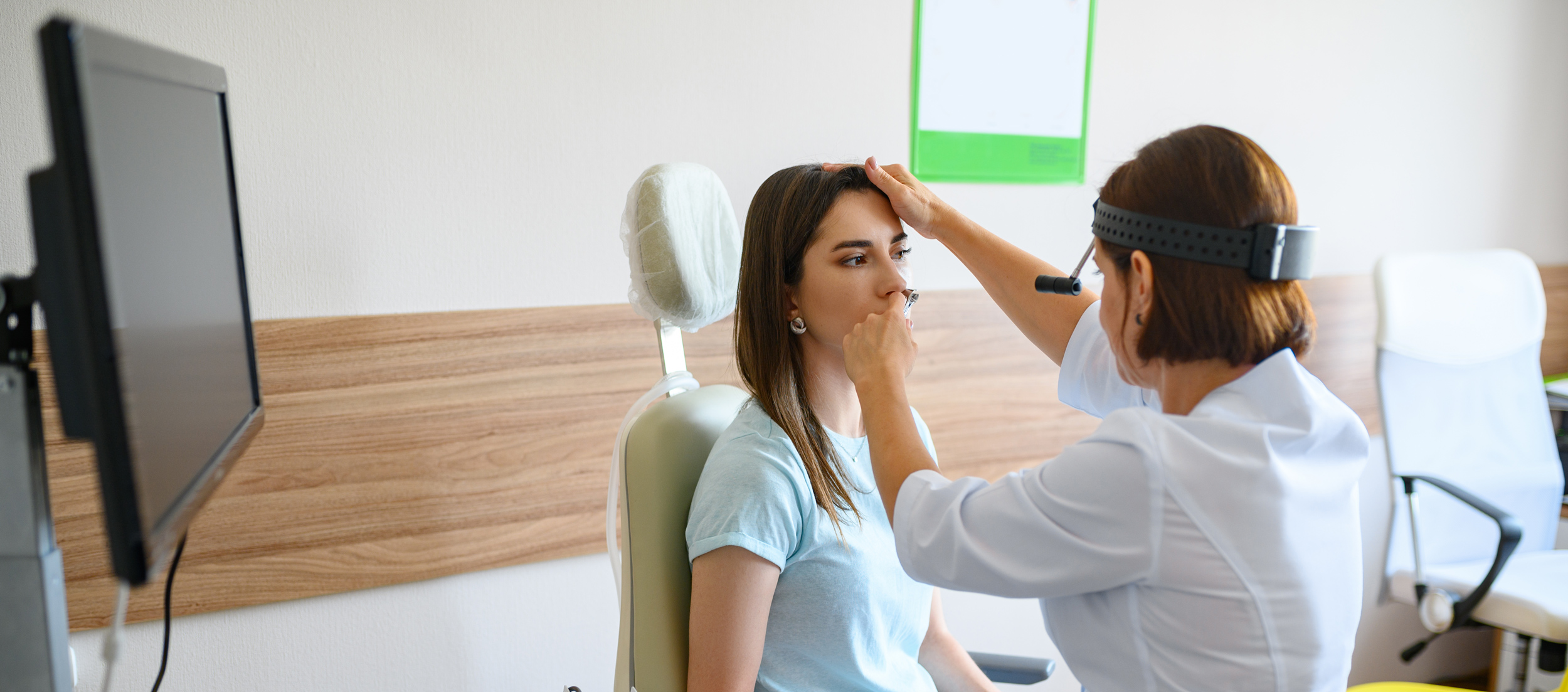 female-doctor and patient examing nose