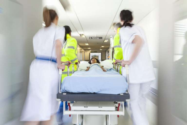 A photo showing a trolley being wheeled through Accident and Emergency to depict how A&E misdiagnosis is a serious problem.