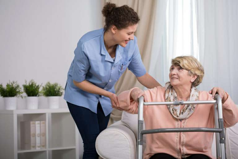 A nurse caring for an elderly lady