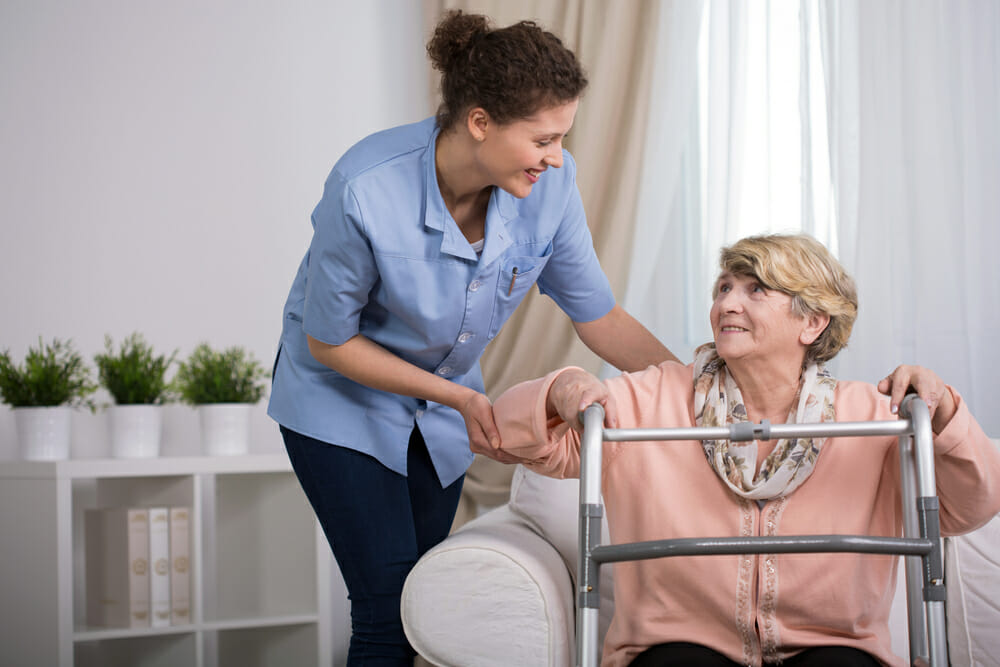 A nurse caring for an elderly lady