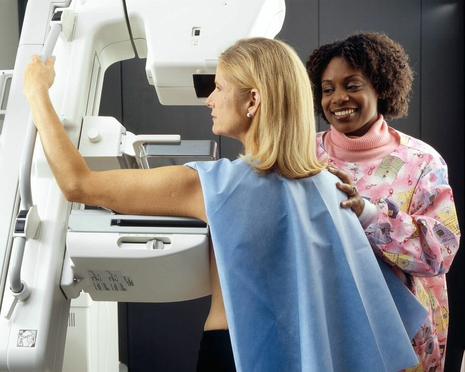 A photograph of a lady having a mammogram in an article about a national breast screening programme failure