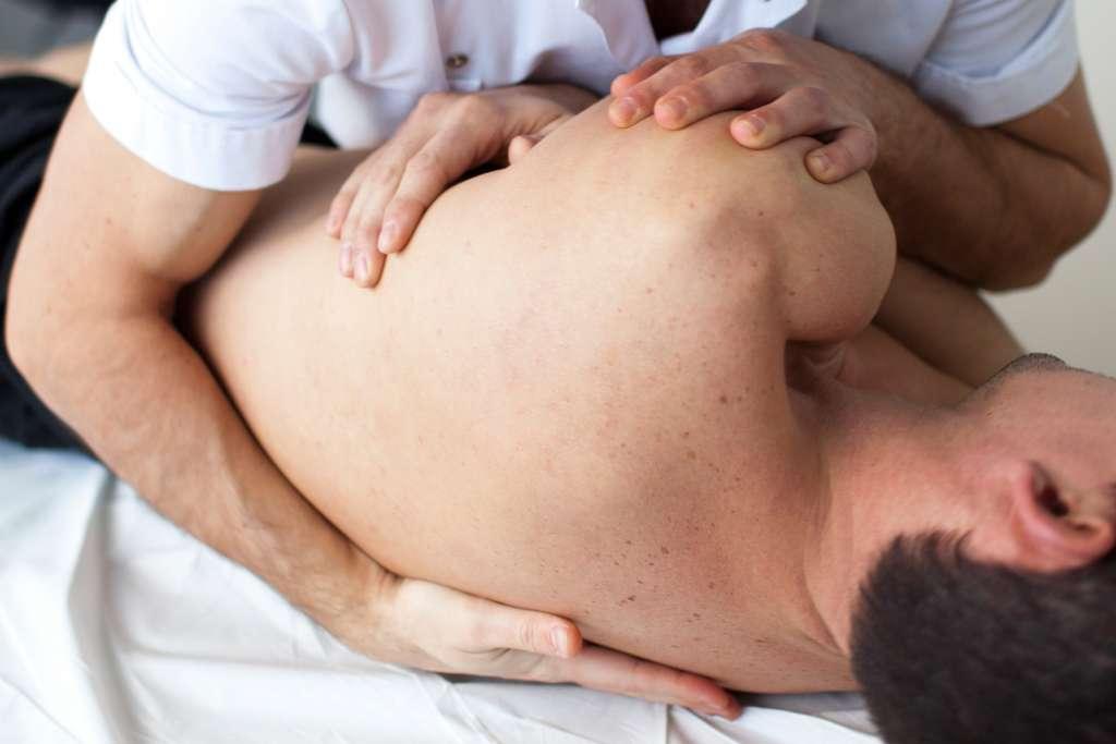 nurse rolling over patient