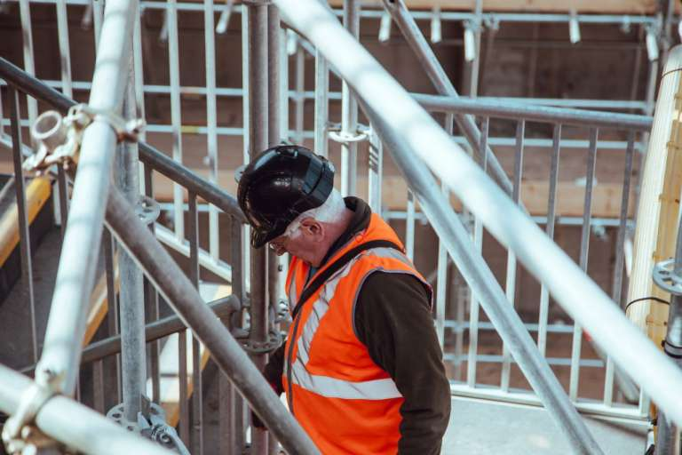 An image of a manual worker on a building site, to accompany an article about health and safety, afte ra construction worker fell from a roof