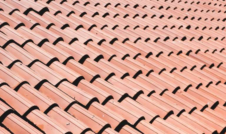 A photograph of a tiled roof. To depict the 'same roof' rule which the CICA have now abolished.