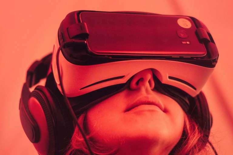 Person using a virtual reality (VR) simulator