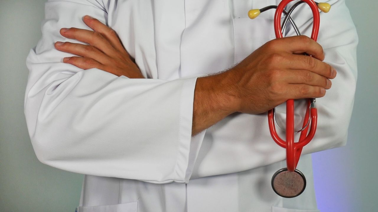 A photography of a doctor holding stethoscope as GPs in london have been asked to restrict specialist NHS referrals.