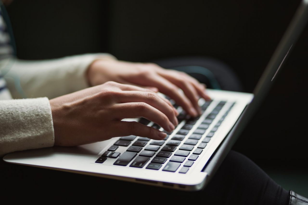A person typing on a laptop keyboard - NHS Complaints
