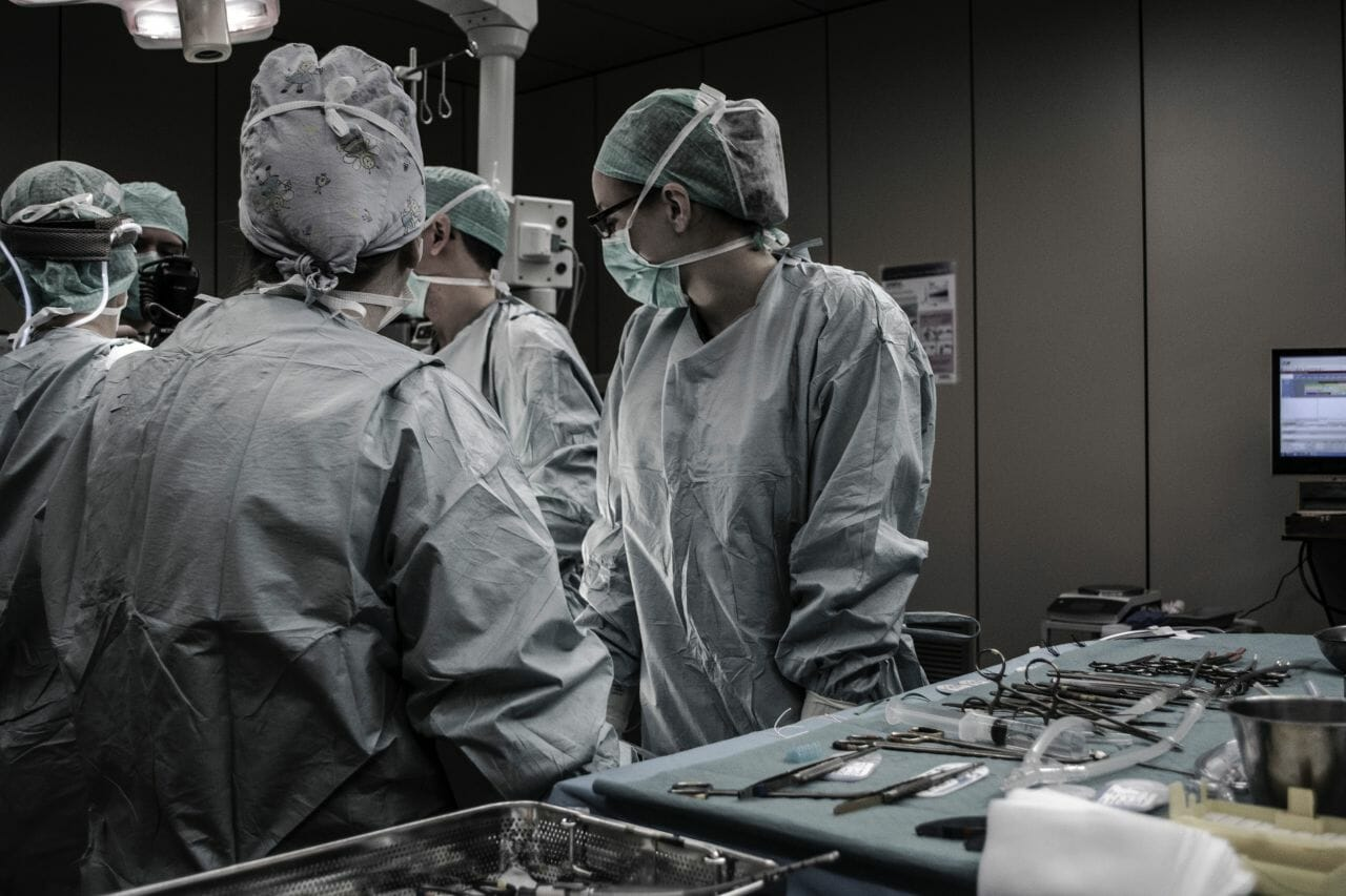 Cosmetic Surgeon carrying out surgery on patient. Under new rules, the patient would have to undergo a two week isolation before surgery.