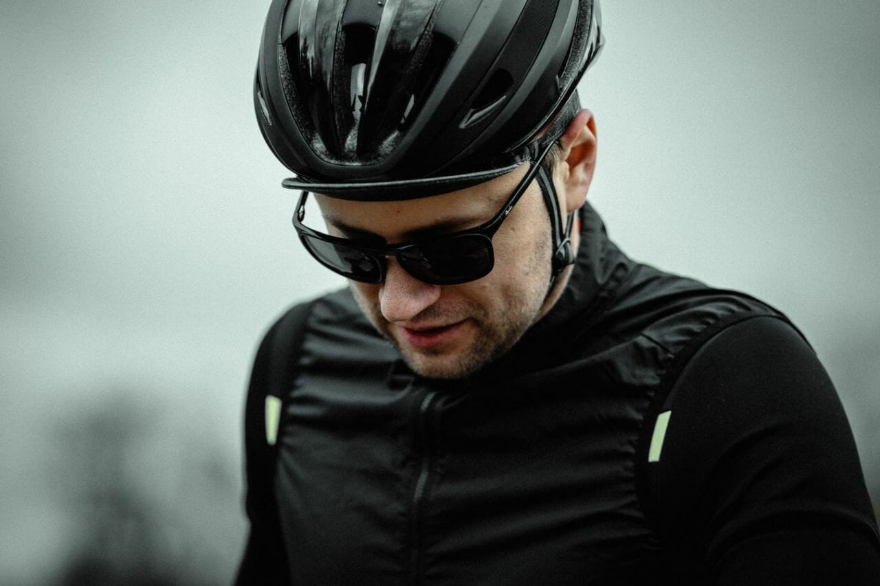 """A cyclist, off his bike, in a black helmet and clothing, who might be wondering """"what do I do if I've been knocked off my bike by an uninsured driver?"""""""