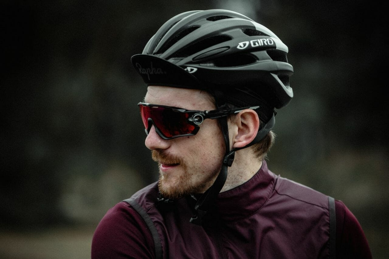 """A cyclist, off his bike, in a black helmet and clothing, who might be wondering """"what do I do if I've been knocked off my bike by a hit and run driver?"""""""