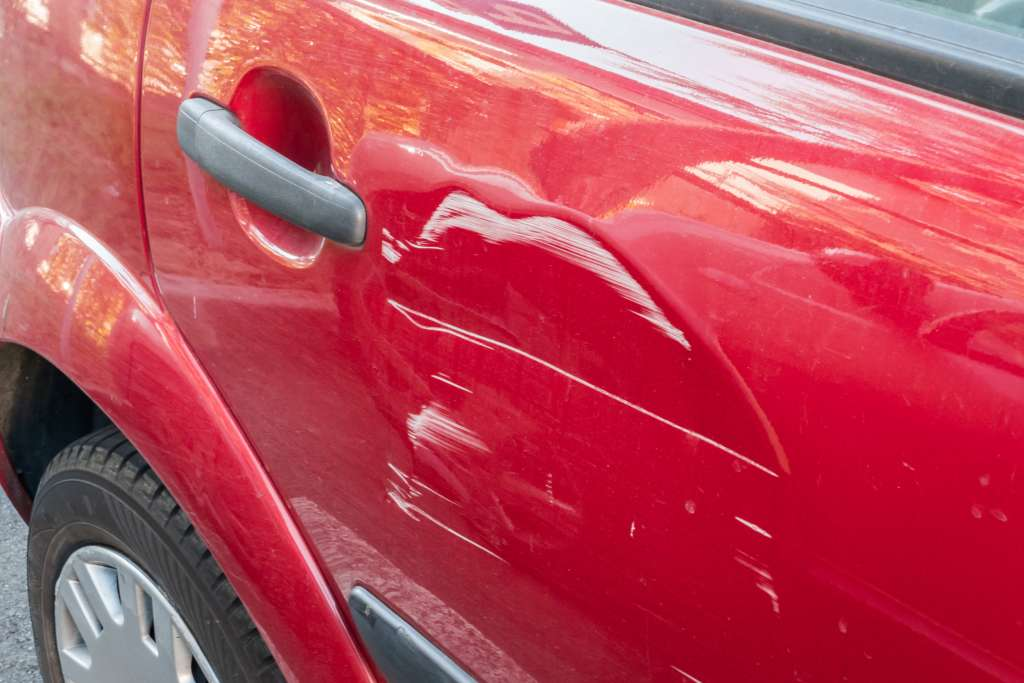 Scratches on the red car