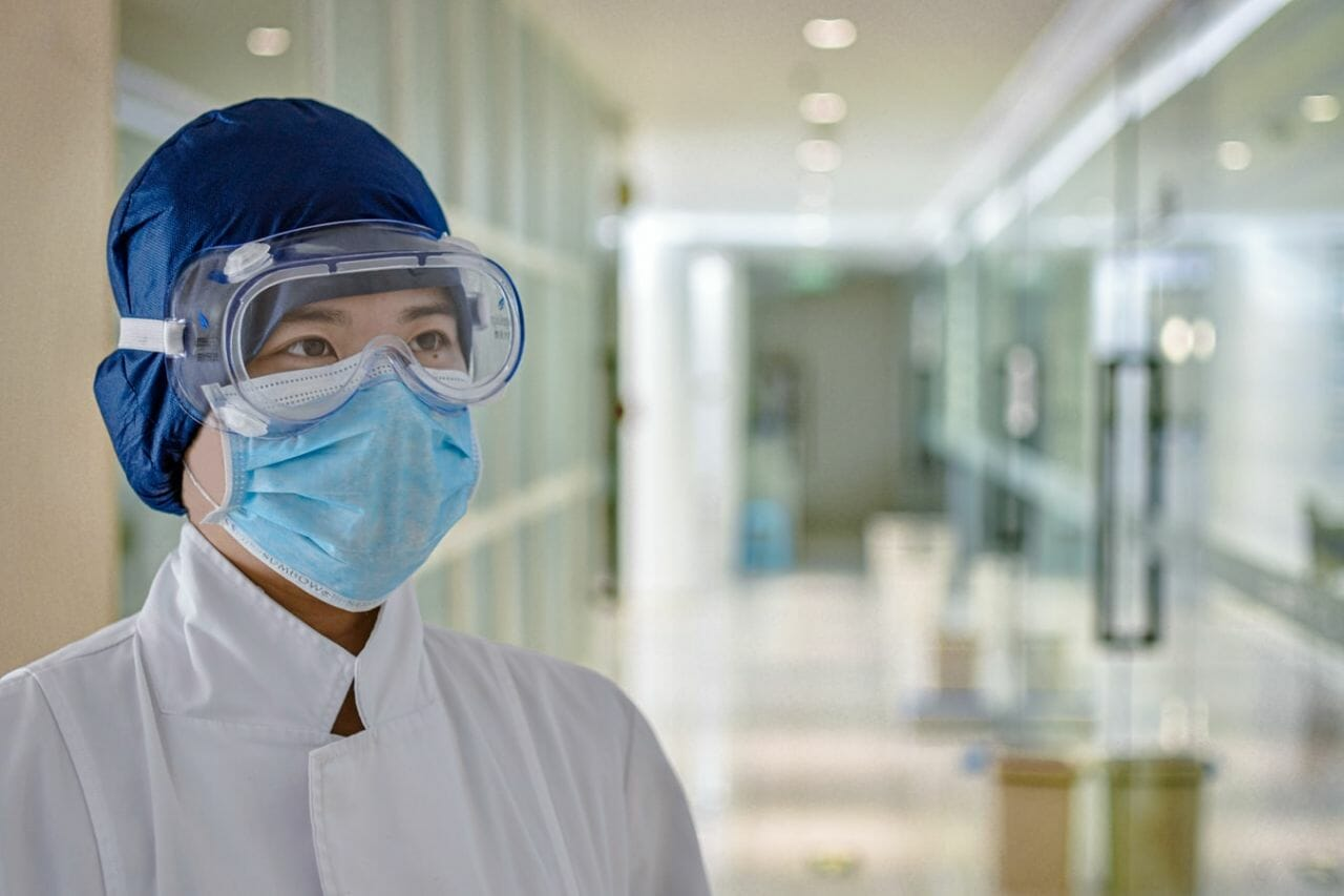 A photograph of a female medical professional wearing protective equipment, to depict the shortage of personal protective equipment for NHS staff.