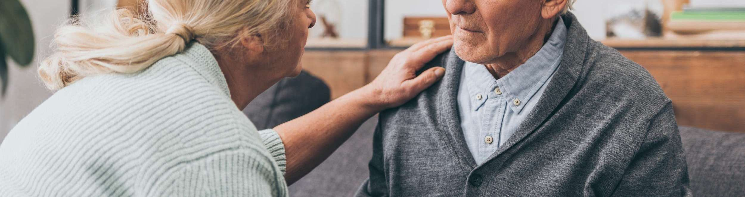 comforting elderly man