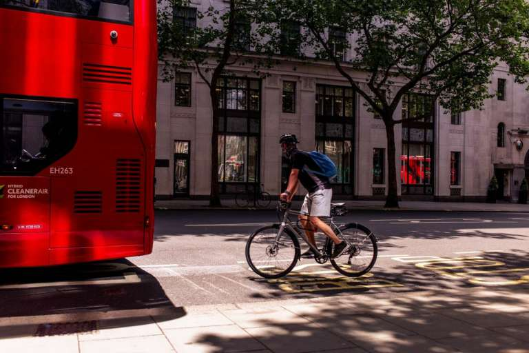 A photograph of a cyclist, riding behind a bus, in London. This is the type of rider that the review of The Highway Code looks to protect - along with other vulnerable road users.