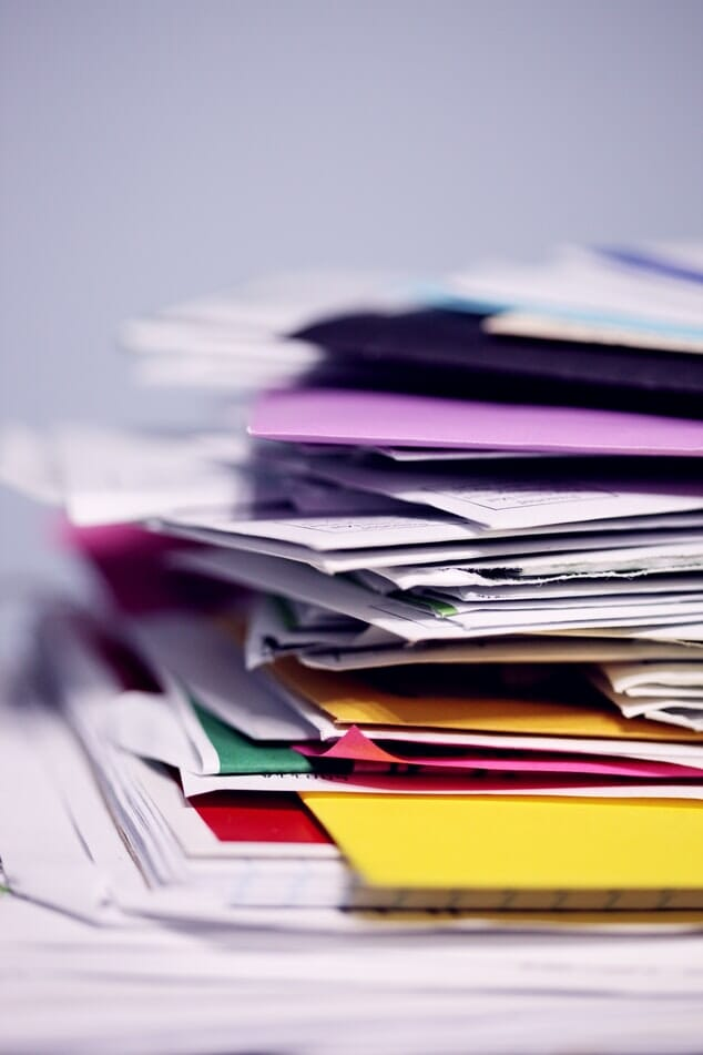 A photograph of a pile of papers to depict the NHS Resolution annual report 2019/20