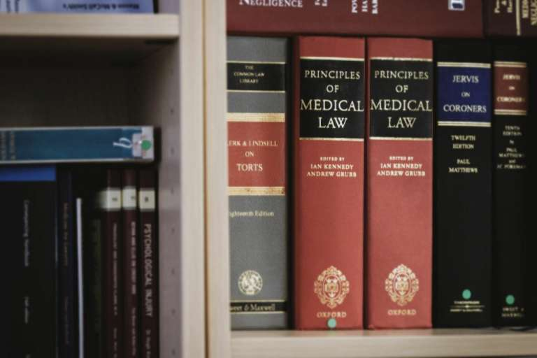 A photograph of some legal books, on a bookshelf, to depict changes to the civil procedure rules, which are due to be introduced.