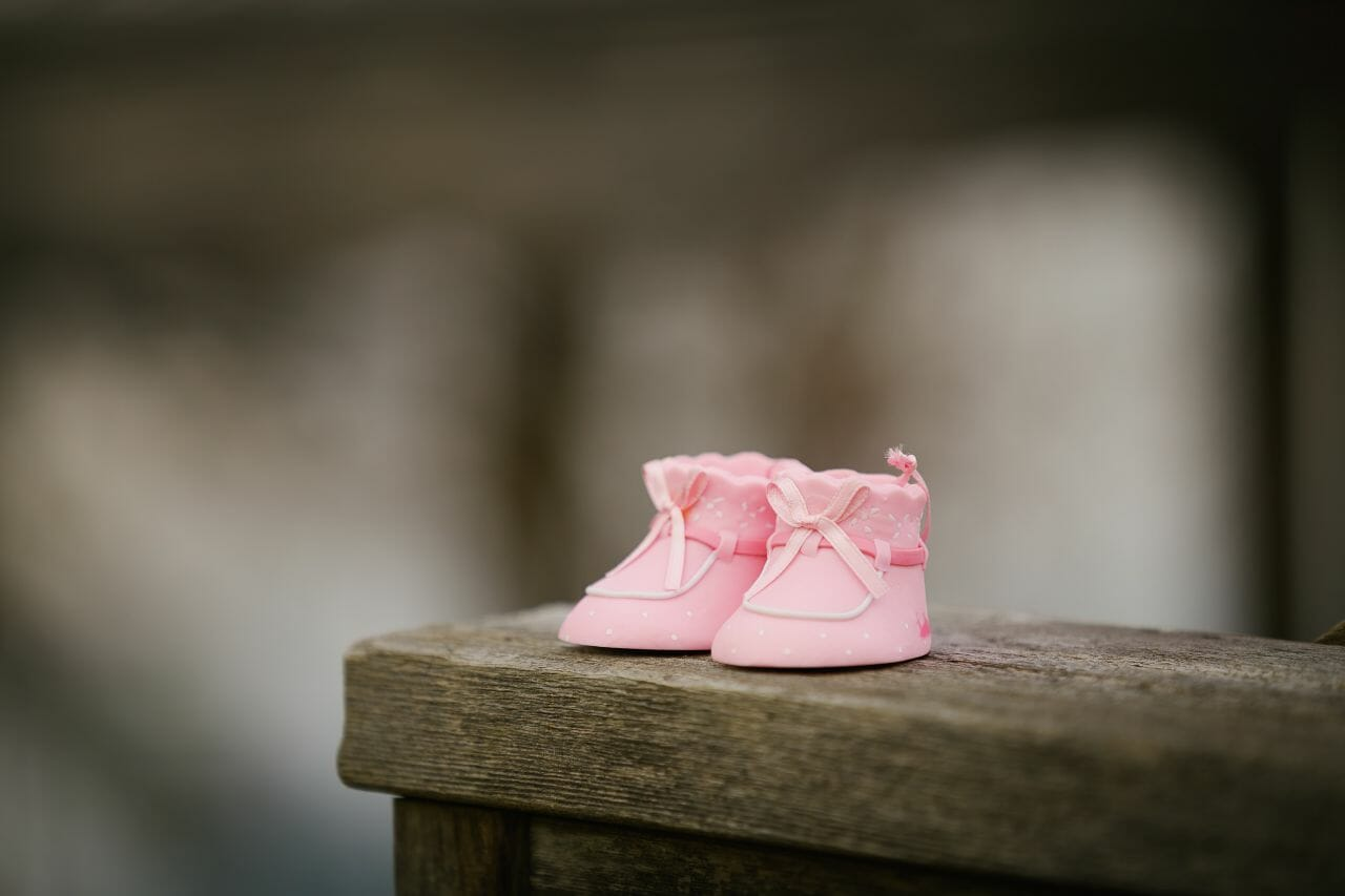 A photograph of a pair of pink baby shoes to mark birth trauma awareness week.