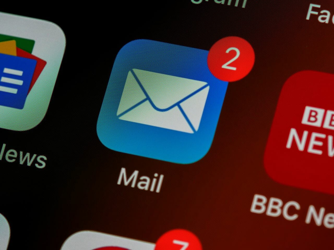 An image of an email icon on an iPhone to supplement an article about service by email for lawyers in England and Wales.
