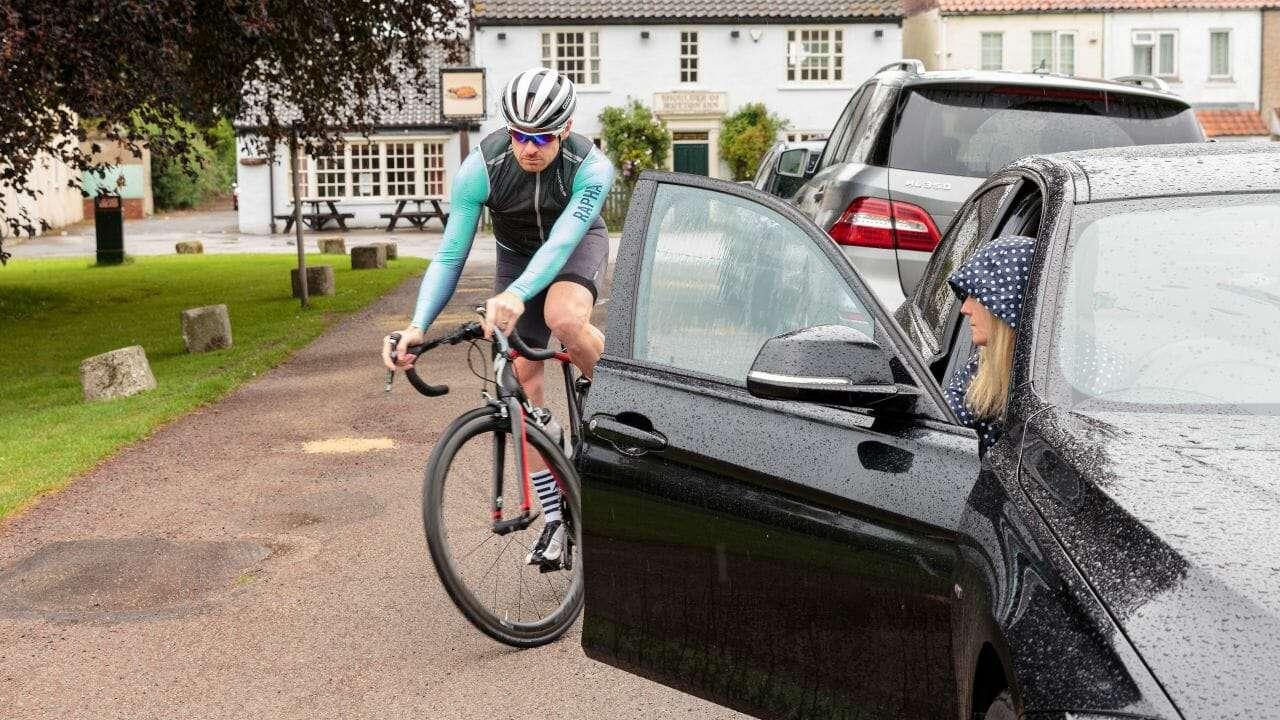Cyclist hit by car door