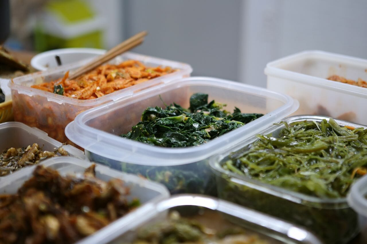 A photograph showing a variety of foods in separate containers to accompany an article about free school dinners for children in school holidays.
