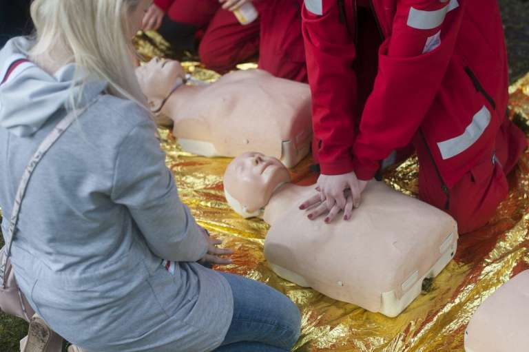 A person demonstrating CPR on a medical dummy. Do Not Resuscitate Decisions were inappropriately applied during the pandemic, potentially costing lives.