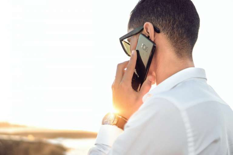 A person speaking on the phone. The case of Pallett v MGN related to the interception of a voicemail.
