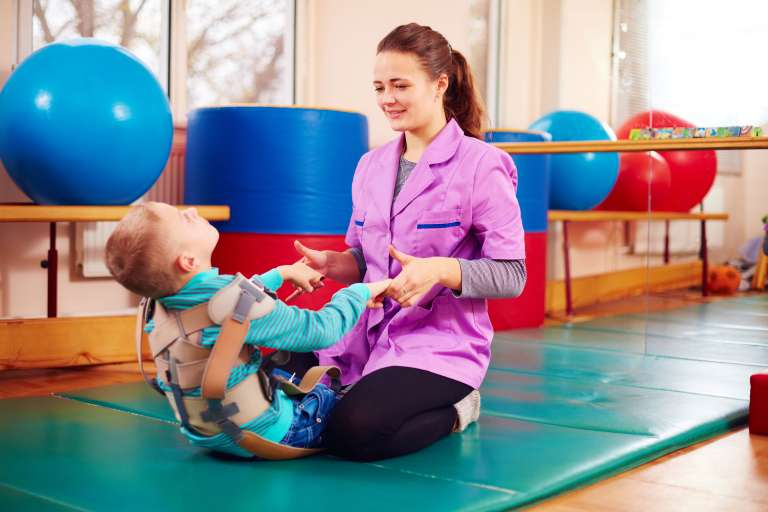 A photograph of a child having physical therapy, similar to what a child with cerebral palsy might have.