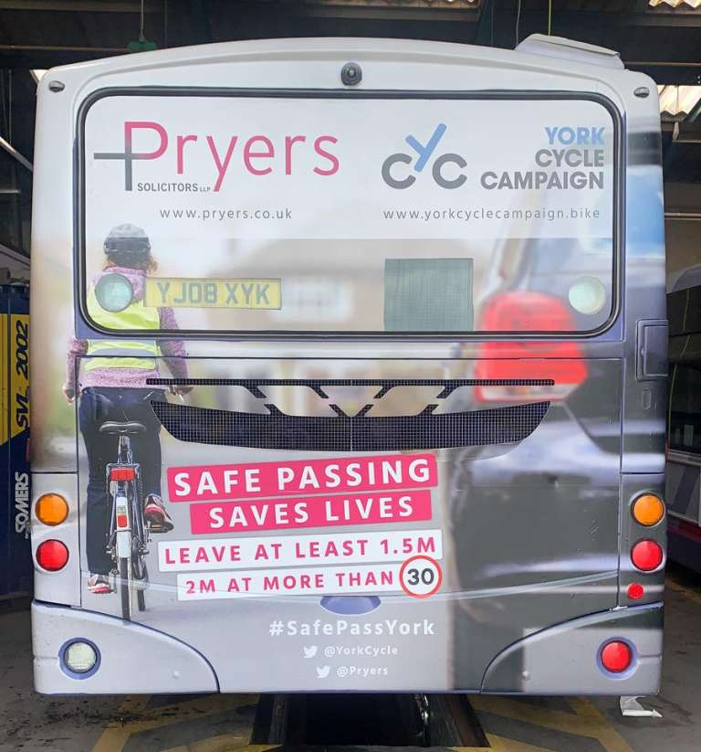 A photograph of Pryers Solicitors and York Cycle Campaign's bus advert to promote safe passing