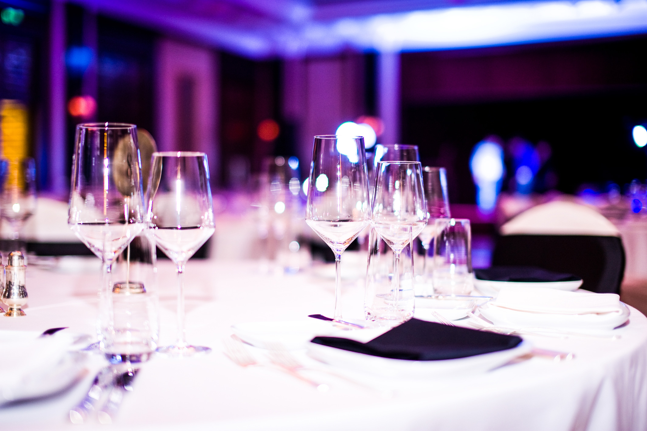 A photograph of a formal dinner table setup